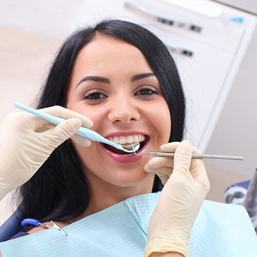 Woman with healthy gums thanks to Charlottesville Family Dentistry