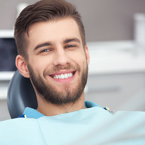 Relaxed man after having sedation as part of Charlottesville Family Dentistry