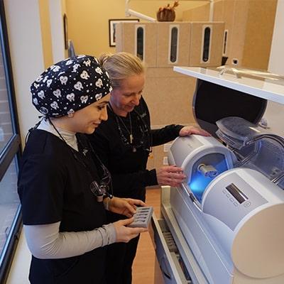 Dentists using CEREC machine