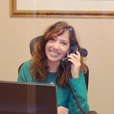 Charlottesville New Patients are given a variety of financing options and here is a team member smiling, ready to help